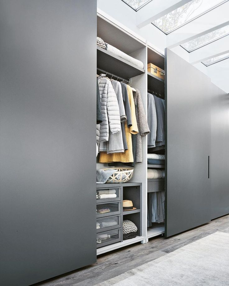 Precision-engineered | Truly Customisable – Lema's Armadio al Centimetro Fitted Wardrobe System demonstrates complete flexibility. Doors are available in a multitude of styles and profiles. Creating a truly unique, intimate and timeless wardrobe space. #interiors #interiordesign ⠀#interiordesignideas #interiordecor #wardrobe #skylight #moderninteriordesign #interiorstyling #grey #builtin