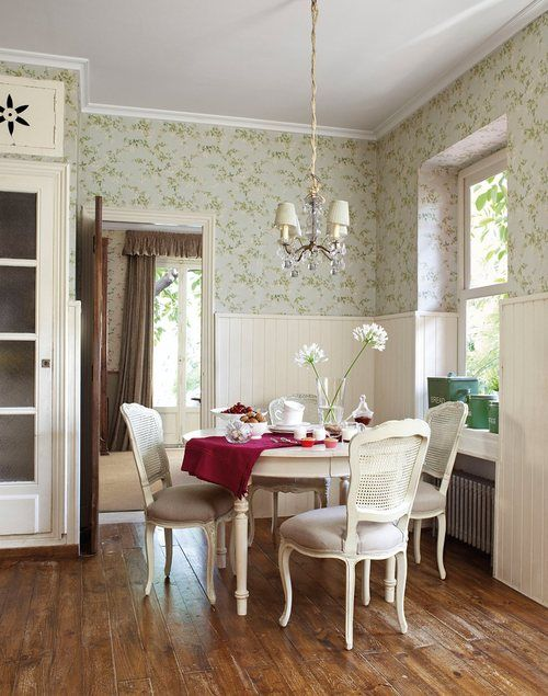 Older home/sweet little dining room with wall paper.