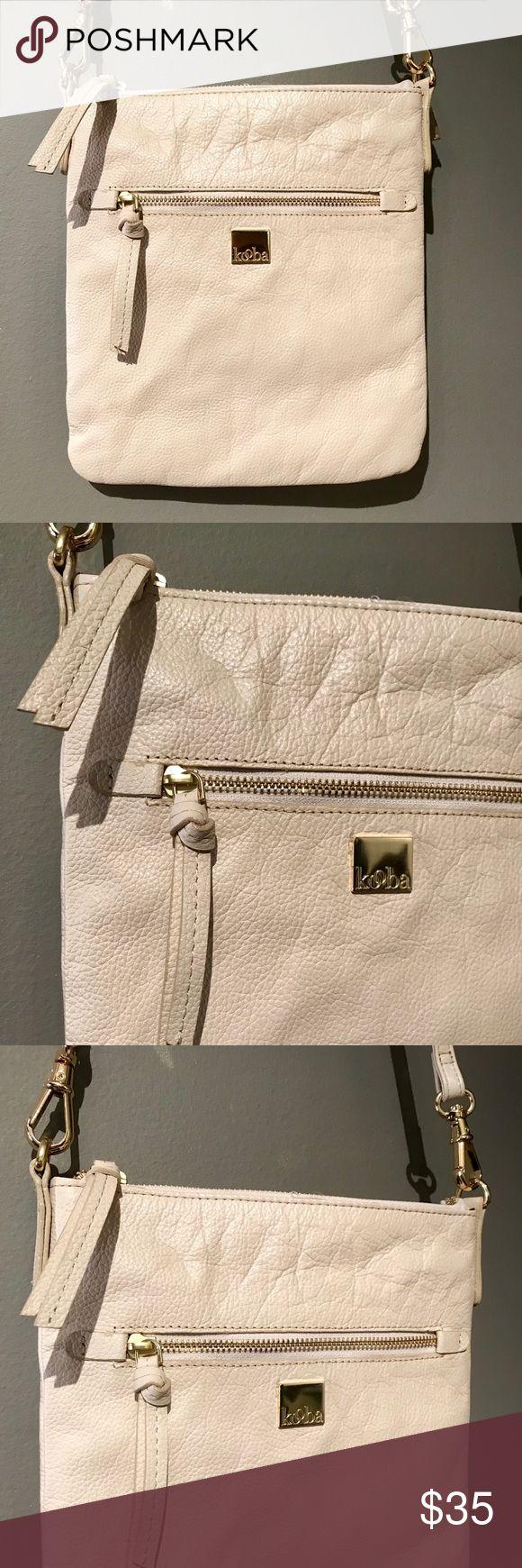 Kooba pebbled leather crossbody handbag Kooba pebbled leather crossbody in stone with interior zipper, cell phone and utility pockets and a back pocket. Has a 24 inch adjustable and removable strap. Kooba Bags Crossbody Bags
