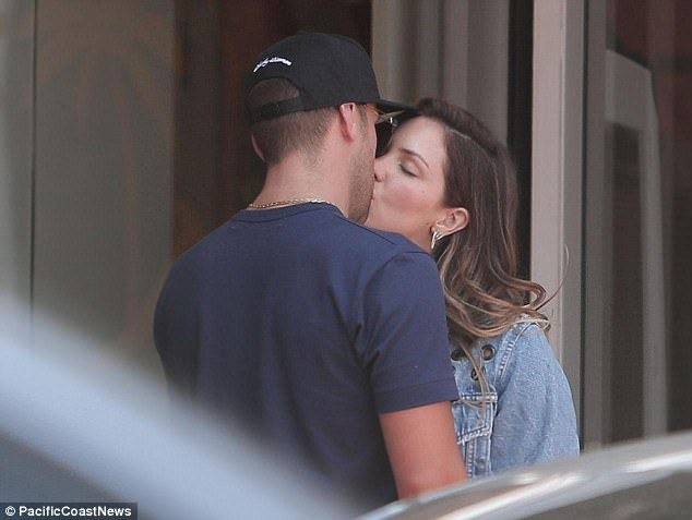 Sealed with a kiss!Katharine McPhee looked as smitten as ever as she was spotted locked in a passionate kiss with her new boyfriend, Nick Harbone