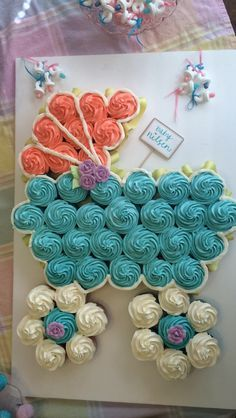 Baby carriage cupcakes! Baby shower hit! Peach, teal & lavender buttercream cupcakes.