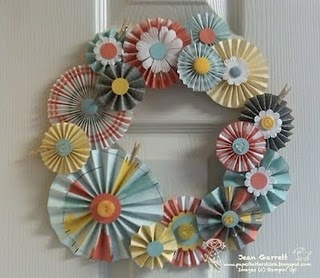 Paper rosette wreath. {note to self: I think this would be so nice made of Christmas paper for a Holiday wreath}http://paperbatterstitch.blogspot.com/2011/08/accordion-rosettes-domestic-goddess.html
