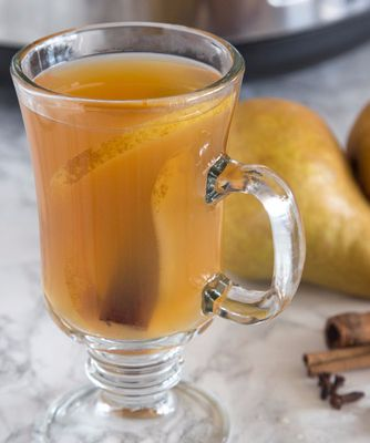 Slow Cooker Spiced Pear Cider - Warm up with a cinnamon and clove Spiced Pear Cider.  Perfect for those cold winter days. Make this yummy recipe in the Crock Pot and let simmer for 3-4 hours on high or all day on low while you are at work. Your home will smell wonderful! This is a great treat for kids and adults and an easy drink to serve at parties...especially during the fall and winter months.