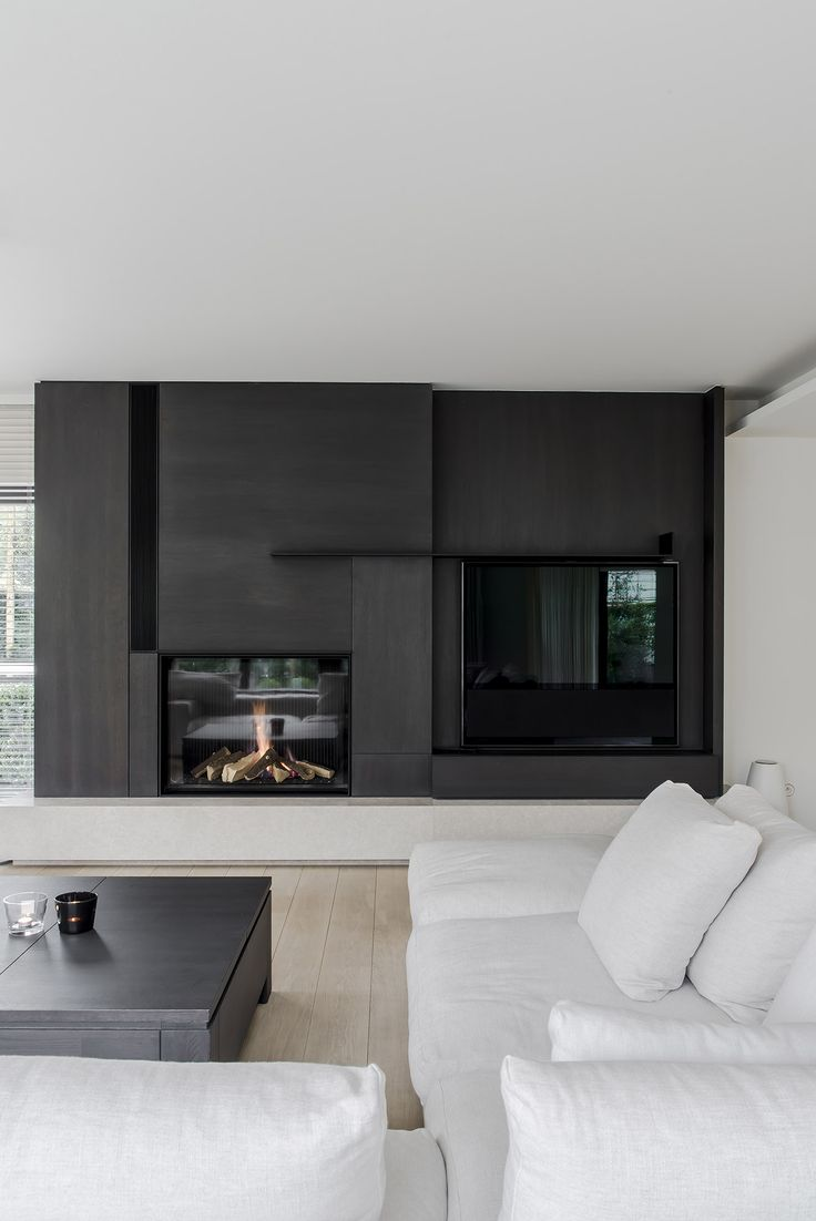 Too dark but study this - like the stone base Fire place - Residence H in Knokke Belgium by Frederic Kielemoes