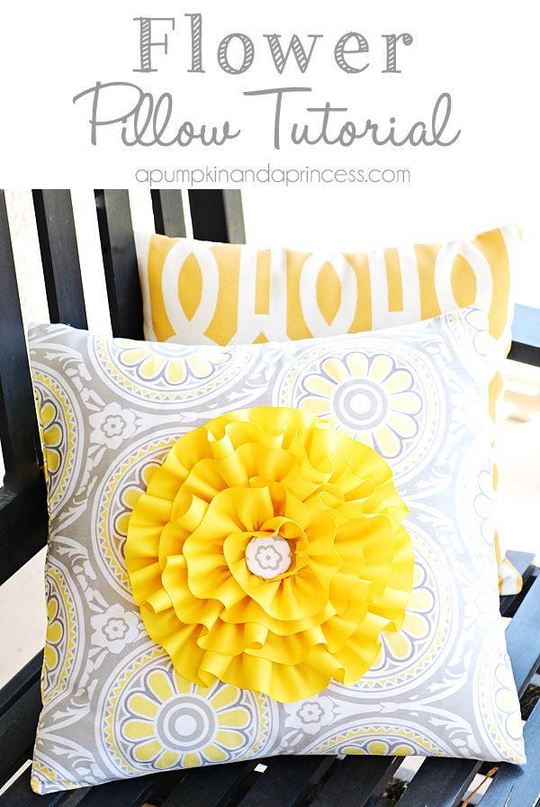 I love that she made this flower removable. I would probably sew the flower instead of hot glue....Flower Pillow Cover {HGTV Fabric}