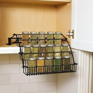 Rubbermaid Pull-Down Cabinet Spice Rack $35.39 The Little Paris Kitchen has open shelves and lots of wire storage solutions. I love this fold-out spice rack. — Valorie Hart Product Specifications:      Sold By:Target | Visit Store »     Category:Cabinet And Drawer Organizers     Style:Contemporary