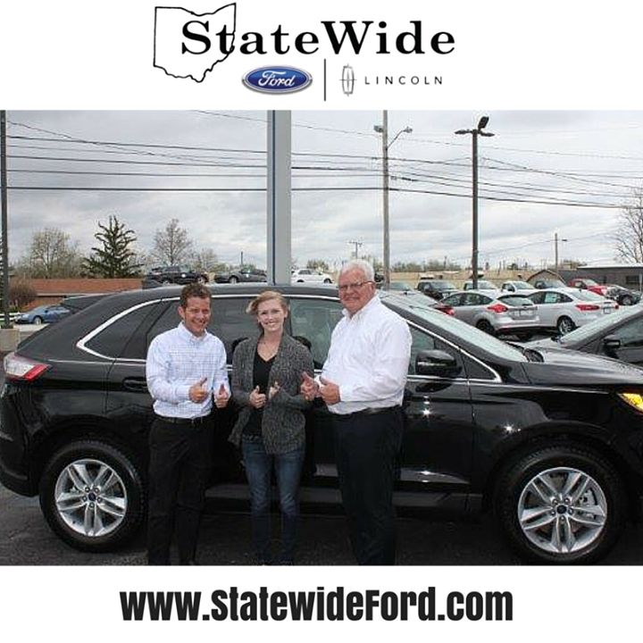 Katie Brita taking delivery of her new Ford Edge from Randy Custer and Brad Greve. Thank you for your business Katie.