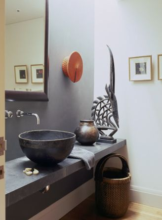 Orange Zulu hat wall mounted in a bathroom by Hare + Klein