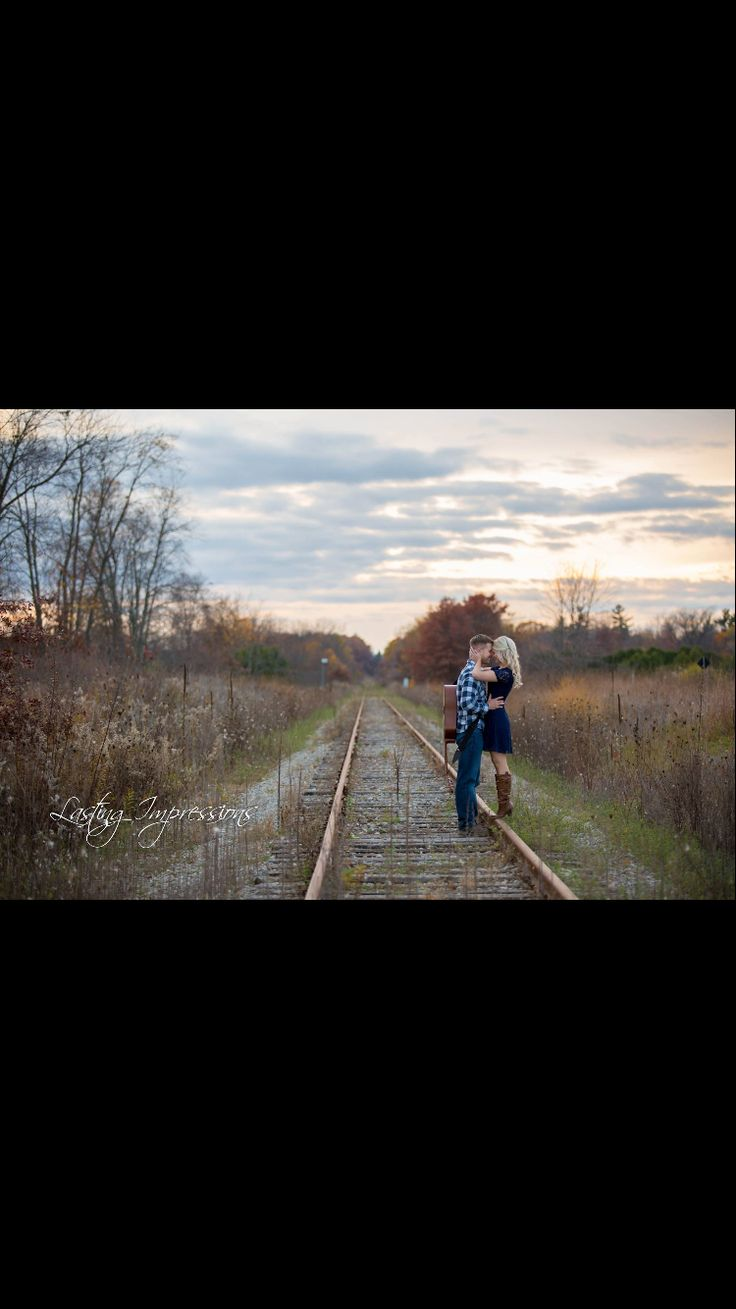 Engagement photography. Ontario. Lasting Impressions. By Helen Mels. Sunset, railroad, guitar.