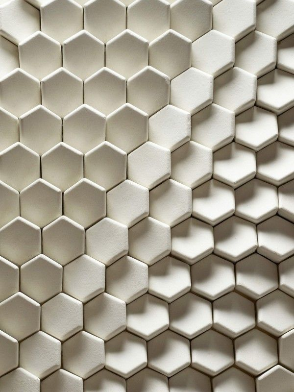 Alexander Tile    Available in glazed or matt finish in an extensive variety of colours and finishes, this clever little tile is supplied with a variety of varying angled faces, which when laid in formations can create different shades on a surface.