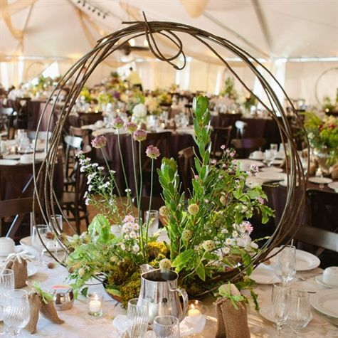 The wreath-like centerpieces gave minimal, visual obstructions but still added a different volume texture. All of the tables gave a look that this design could be seen in nature: the colors, the textures, and the even the bird feathers. from the album: An Elegant Country Wedding in Darby, MT