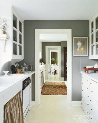 Gray kitchen and pantry: The butler's pantry leads to the kitchen and the breakfast room; the 1920s cabinetry has laminate counters, and the walls are painted in Benjamin Moore's Chelsea Gray.