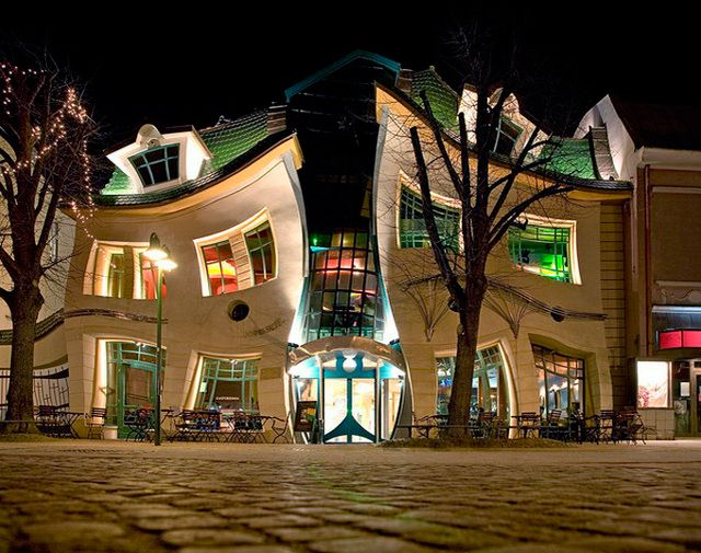"Krzywy Domek (""Crooked House"" in English) is a unique shopping center in Sopot, Poland designed in 2004 by the architecture firm Szotynscy & Zaleski. The building's crazy lines make it look more like a cartoon fun house than a shopping center. According to Wikipedia, Szotynscy & Zaleski were inspired by the fairytale illustrations of Jan Marcin Szancer and Per Dahlberg."