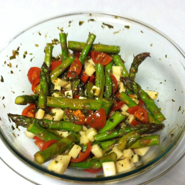 Asparagus salad: sauté asparagus in EVOO, salt & pepper. Chop cherry tomatoes & mozzarella & put in bowl. Add chopped basil. Once asparagus is cooked toss it all in balsamic vinegar!