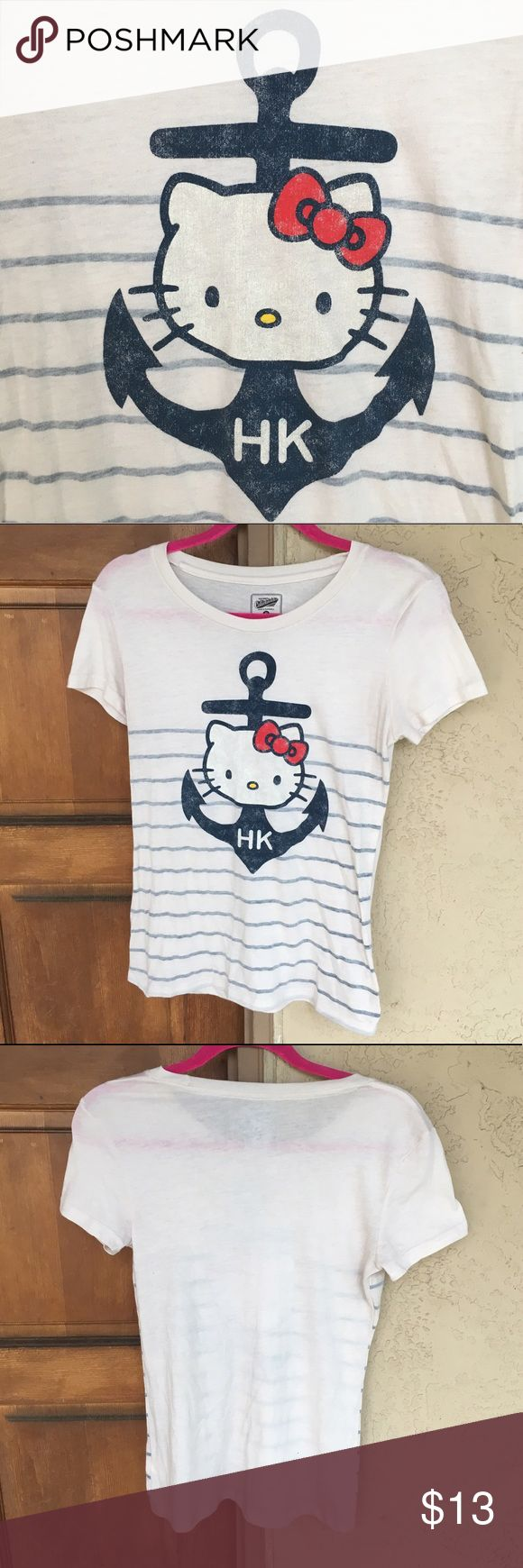 🆕 Nautical Hello Kitty Tee ✨Brand New!✨ Super cute basic cream tee with nautical Hello Kitty theme screen-print, navy anchor & horizontal stripes by Old Navy Collectabilities Collection. Size XS, could also fit a S/M. Comfy & stretchy 50% cotton & 50% poly. Never worn & no flaws! 🚫No Trades or Paypal. 👍15% off 3+ item bundles! Old Navy Tops Tees - Short Sleeve