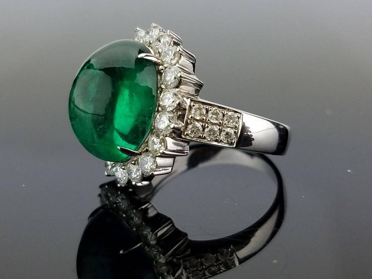 8.35 Carat Zambian Emerald Cabochon and Diamond Cocktail Ring | From a unique collection of vintage cocktail rings at https://www.1stdibs.com/jewelry/rings/cocktail-rings/