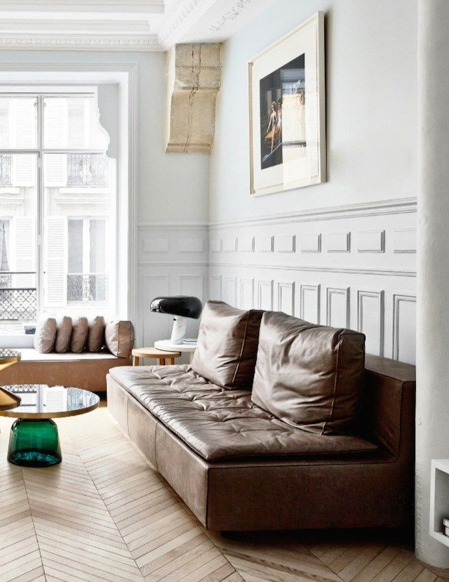 This parisian living room, with its gorgeous 19th century features and classic design pieces, makes my heart sing.