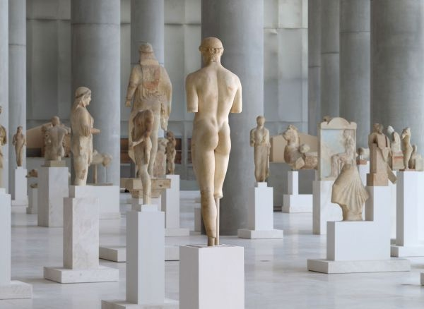 Second level of new Acropolis museum. Kouroi and kores of the archaic era.