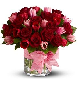 "Tell someone, ""I love you!"" with two of nature's most beautiful blooms - fragrant crimson roses and delicate pink tulips."