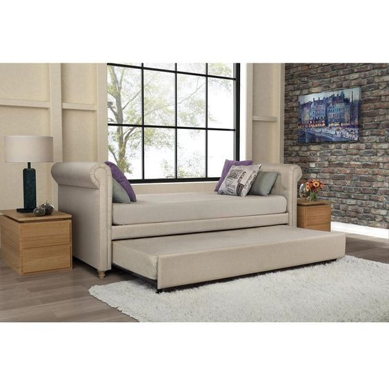 For a versatile and stylish furniture piece, get this trundle daybed for your home. The daybed provides a comfortable seating area upholstered with tan linen fabric, and it also offers the option of s