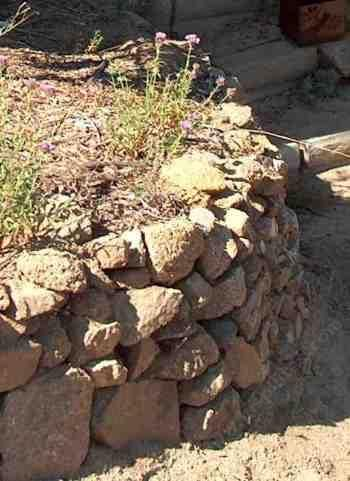 how to build a rock wall or cheap retaining wall...