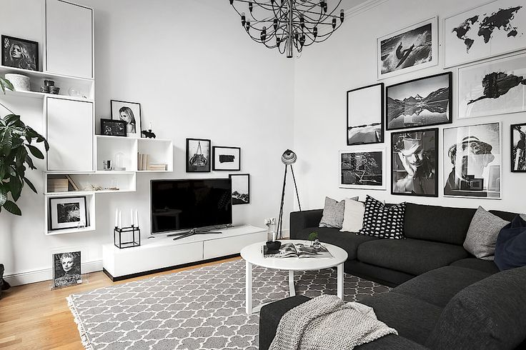 Black and white living room filled with art