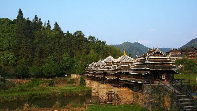 Chengyang Bridge (also known as Wind and Rain Bridge) was built in 1916, and it is the most famous among the wind and rain bridges in the Do...