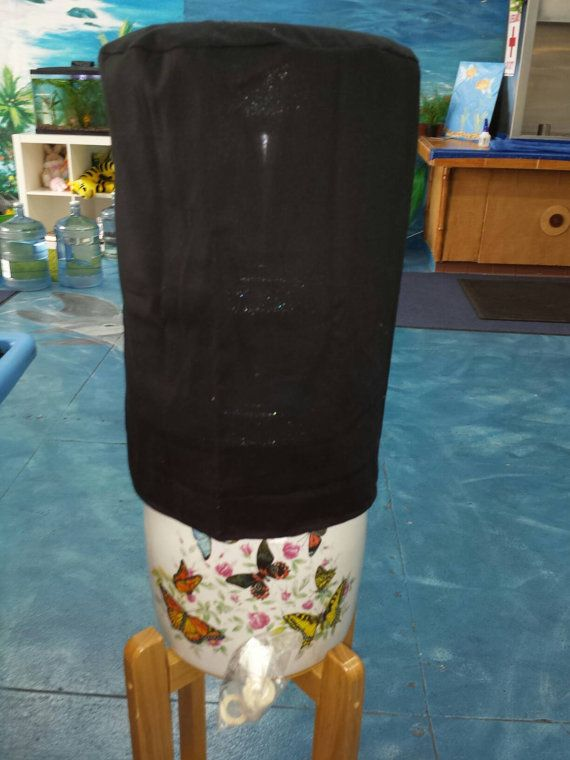 Check out this item in my Etsy shop https://www.etsy.com/listing/274381622/5-gallon-water-bottle-cover-black