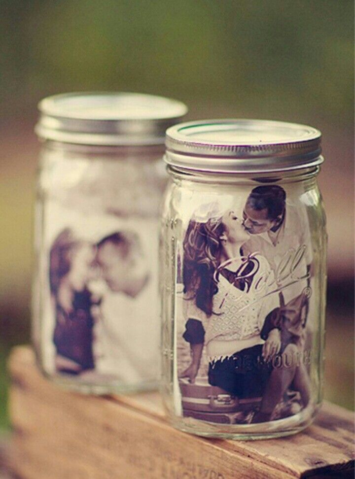 Engagement photos in mason jar set as a centerpiece for your tables. p.s don't let anyone see engagement photos til the wedding.