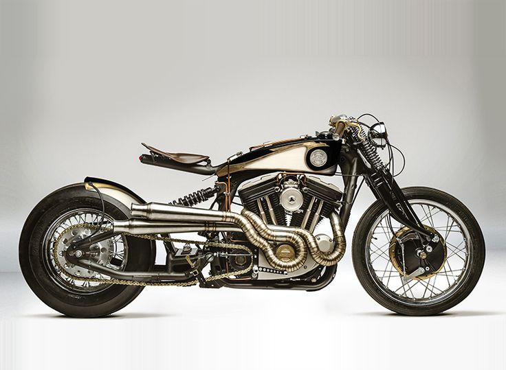 south garage's 'opera' motorcycle's curved spine features a black stretched and stainless fuel tank lowering its profile, highlighted with exquisite copper and brass accents.