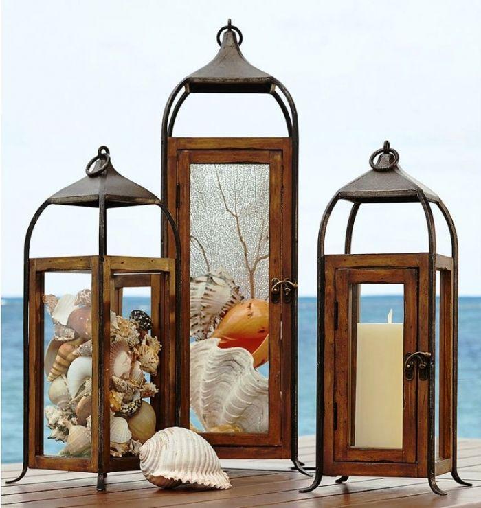 Musim panas akan terasa teduh di malam hari dengan menyalakan lentera yang bertema pantai ini #lamp #gardenlamp #shell #kerang #beachthemedlamp #beach #lantern #lentera #lampuhias