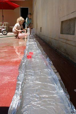 A tin foil river to float bottlecap boats on -what fun!!!! [this is really cool]