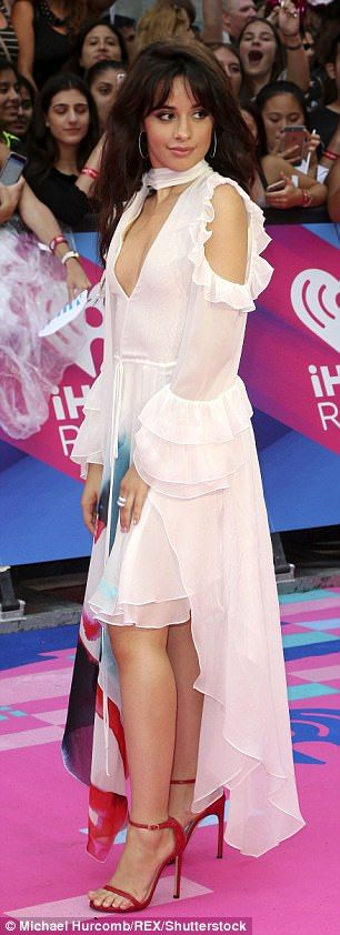 2017 iheartRadio Much Music Video Awards - Camila Cabello opted for two contrasting looks A white dress, featuring an asymmetrical hemline, Camila's detailed dress was dip-dyed turquoise blue and red around the bottom looks at the 2017 iHeartRadio Much Music Video Awards in Toronto..