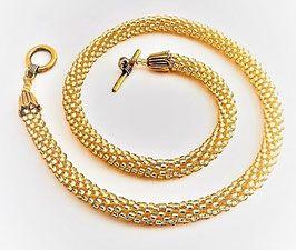 Halskette - Rocailles 3mm, Gold Topaz mit Silbereinzug, auf reißfesten Nylonfaden gefädelt mit T-Verschluß und Blütenkelchkappen aus nickel-blei-und cadmiumfreiem silberfarbenem Metall. Durchm. ca. 8 mm, Länge 45 cm