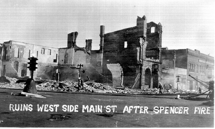 ruins west side of main street, after the fire in 1931.