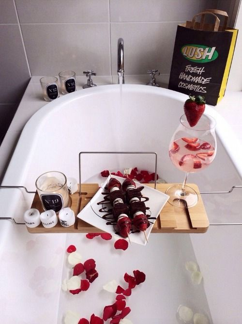 romantical bubble bath - rose petals, candles, fruit kebobs and chocolate, champagne and strawberries.