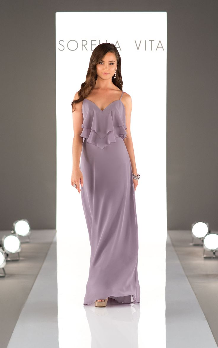 Perfect for the romantic, boho bridesmaid, this floor length chiffon gown features tiers of ruffles that perfectly accent its sweetheart neckline and spaghetti straps.