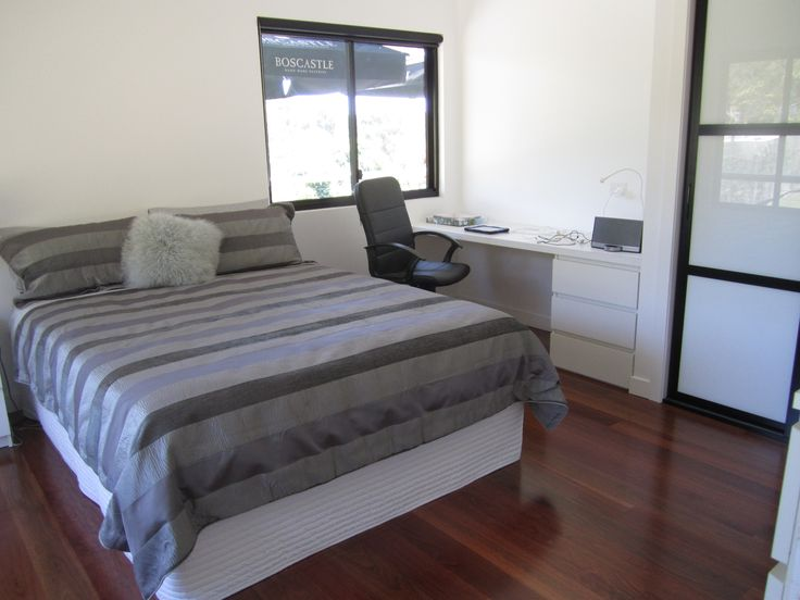 Son's bedroom after reno. New windows and installed sliding wardrobe doors. Added a desk with drawers. Put down new floorboards in grey ironbark.