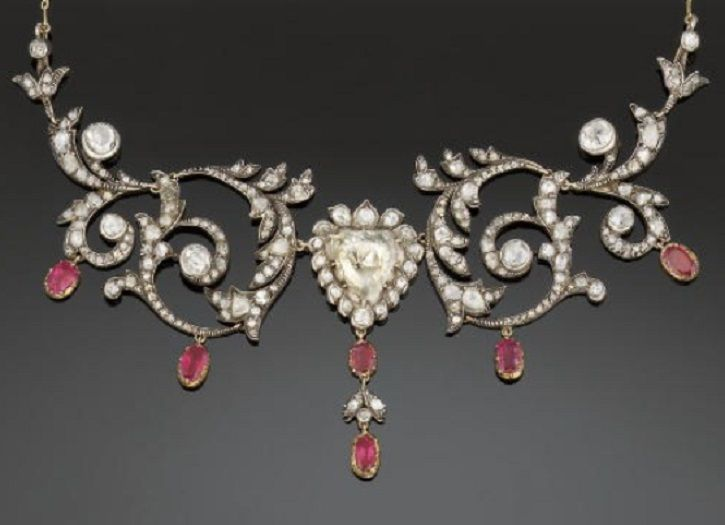 An Antique Diamond And Ruby Necklace, Circa 1890. The front with central triangu...