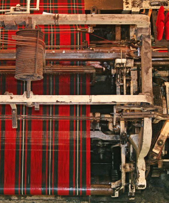Overhead view of a mechanical loom making tartan.  Edinburgh.