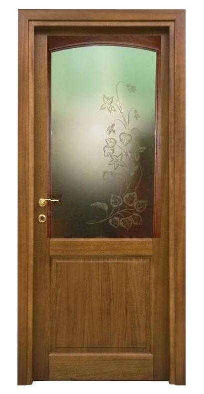 Porta in legno massello Toulipier, due bugne, con vetro nella bugna sueriore con decorazione floreale.  Disponibili varianti decorazioni. porte Piacenza Lodi