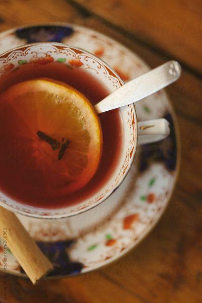 Tea with lemon, cinnamon and cloves. Must taste wonderfully.
