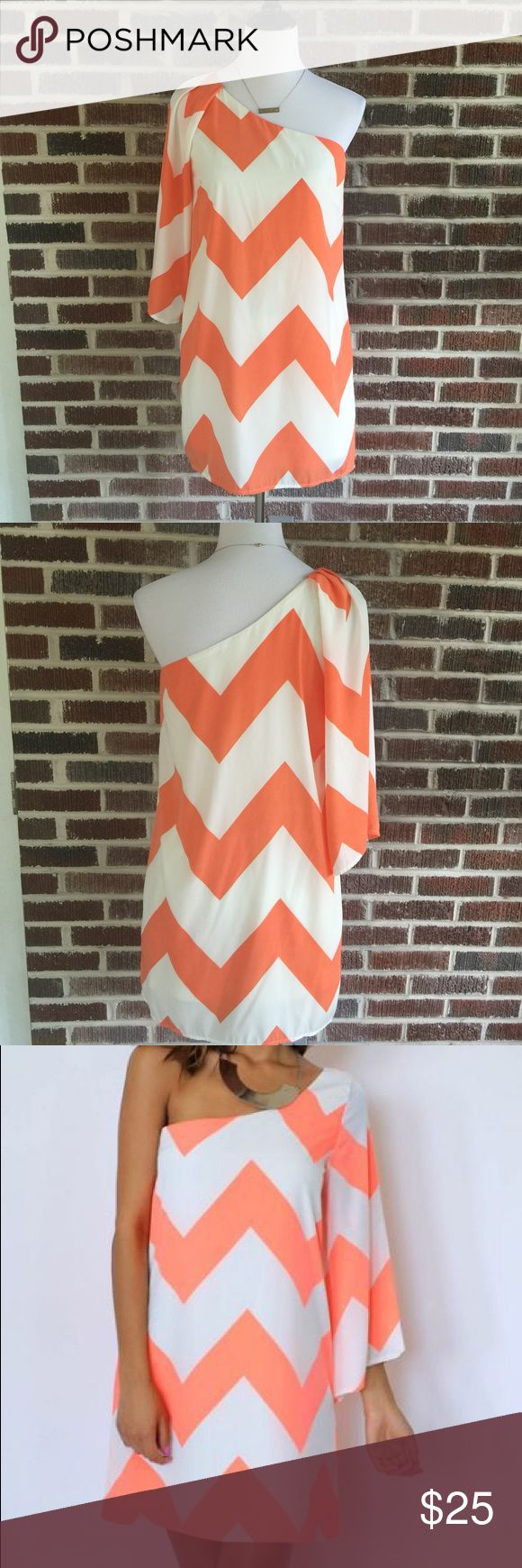 "Pink Owl One Shoulder Coral Chevron Print Dress Adorable One shoulder Chevron print dress by pink owl.  Color is classified as a neon coral, but it doesn't seem too bright.  It's really cute just throw on accessorize and go.  A cute Wedge would be perfect with this dress.  One sleeve is a 3/4 length sleeve.  There is a small flaw as shown in last picture but other than that it's in very good condition.  Length measures 33"". Pink Owl Dresses One Shoulder"