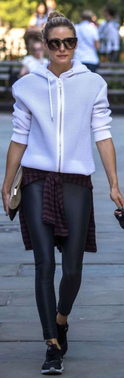 Who made Olivia Palermo's white jacket, black leggings, two tone clutch handbag, and sunglasses?