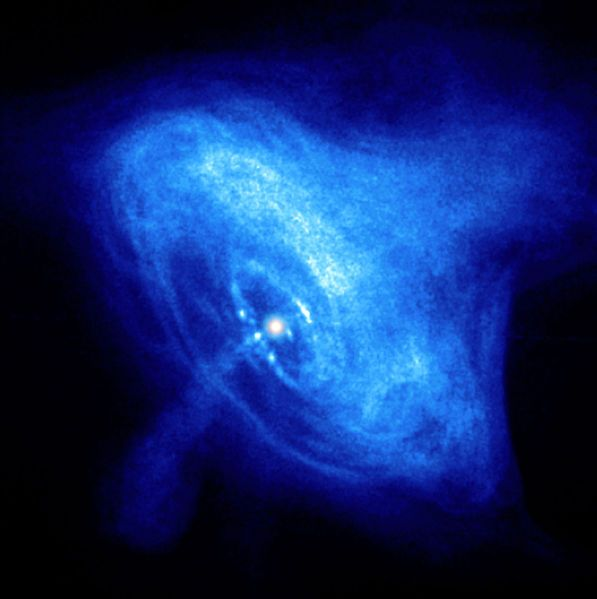 A Hubble Space Telescope photo of a rapidly spinning neutron star, also known as a pulsar. This is the pulsar at the centre of the Crab Nebula in the X-ray spectrum from the Chandray X-Ray telescope. You can see the pulsar at the centre of the whirling clouds of dust with a high speed jet exiting toward the bottom,