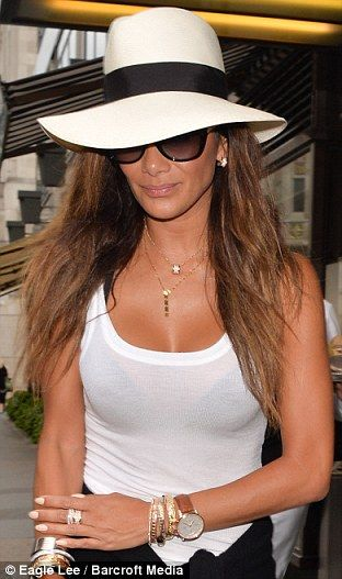 Hot stuff: Nicole accessorized her simple look with two gold pendents and gold and silver ...