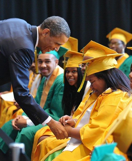 US President Barack Obama greets graduating students before the Booker T. Washington High School graduation ceremony May 16, 2011 at the Coo...