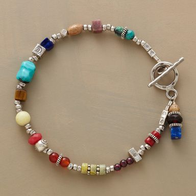 """CARAVANSARY BRACELET -- Sterling beads and charms mingle with colorful gems, including coral, turquoise, garnet, carnelian, lapis, tigereye, jasper, rhodonite and peridot. Sterling silver toggle clasp. Handcrafted in USA exclusively for Sundance. 7-1/2""""L."""