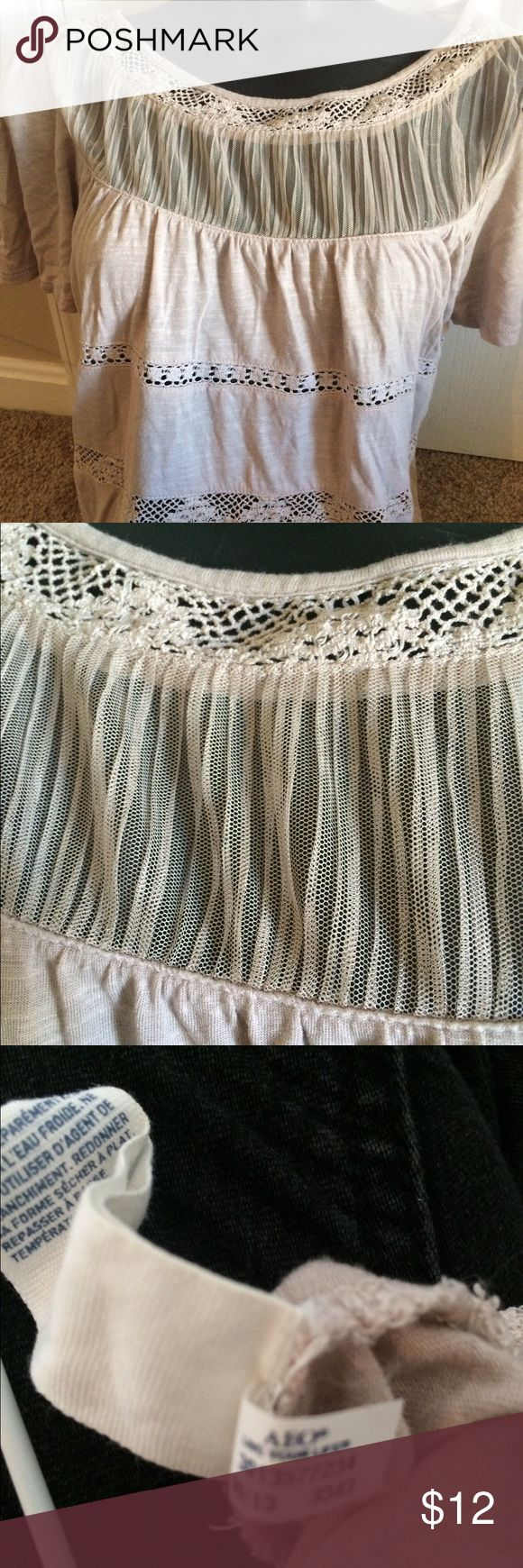 NWOT American Eagle outfitters beige sz small top New without tags's adorable American Eagle outfitters size small top. Adorable lace detail and cool gauze at neck. A basic staples for spring and yet really dresses up an outfit! American Eagle Outfitters Tops Tees - Short Sleeve