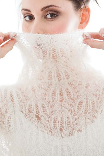 Ethereal blooms of knitted lace tumble throughout this turtleneck pullover. Though intricate, the lace pattern is worked without the complexity of shaping: The oversized fit features drop shoulders, while the long sleeves - which are picked up and knit - are shaped at the stockinette underside panels. Rowan's Kidsilk Haze creates a downy, lofty fabric that drapes to inform your figure. Side seams offer necessary structure.